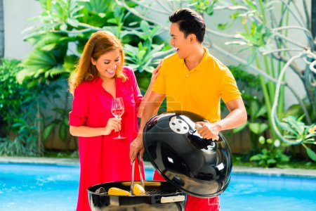 Asian couple having barbecue