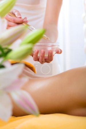 Woman getting body massage