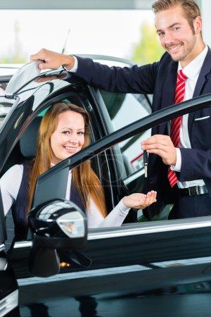 Dealer, female client and auto