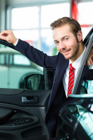 Auto dealer in car dealership
