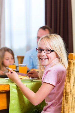 Family eating lunch or dinner