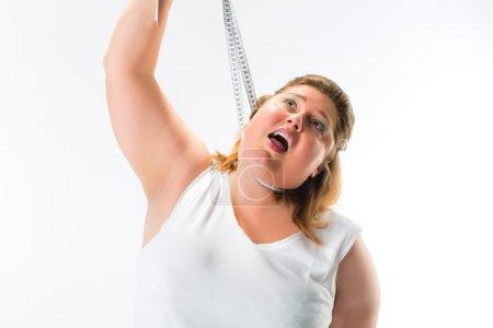 Obese woman strangling herself