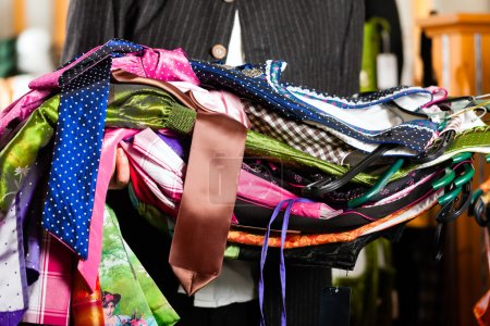 Man is buying Tracht or dirndl in a shop