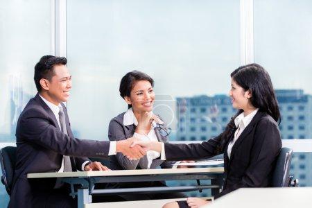 Asian recruitment team hiring candidate