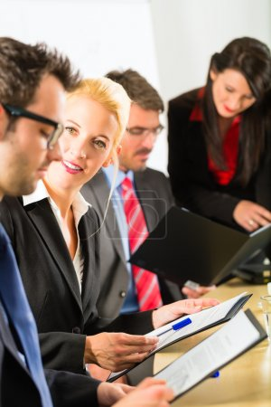 Photo pour Business - businesspeople have a meeting or workshop with presentation in office, they negotiate or sign a contract - image libre de droit