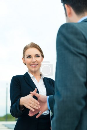 Photo for Business handshake - two businesspeople shaking hands to conclude deal or agreement - Royalty Free Image