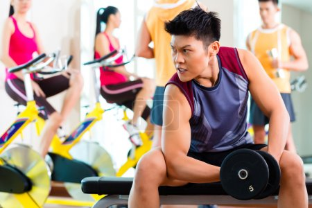 people exercising sport for fitness in gym