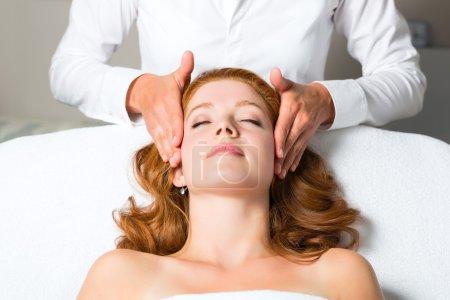 woman getting head massage in Spa