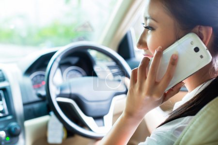 Asian Chinese young woman telephoning with mobile ...