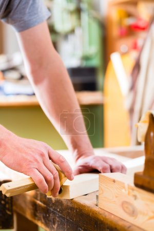 Carpenter with workpiece in carpentry