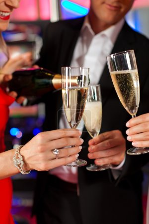 People with champagner in a bar