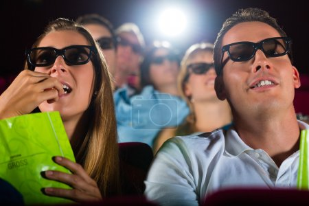 people watching 3d movie at movie theater