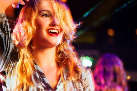 Woman in club or bar having fun