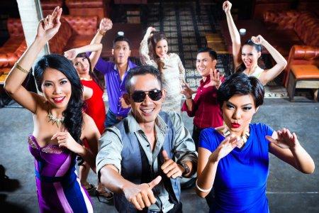 people partying on dance floor in nightclub
