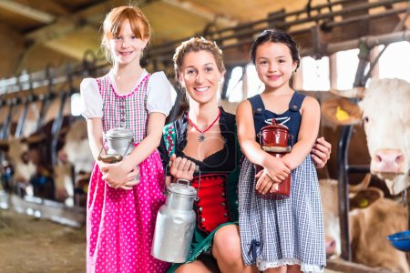 Photo for Bavarian family with milk can on cow farm - Royalty Free Image