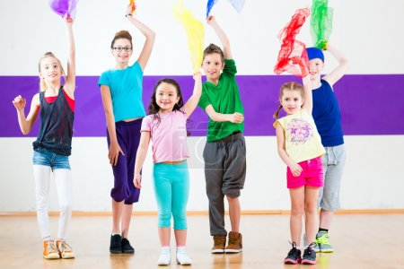 Kids in dancing class traninng with scarfs