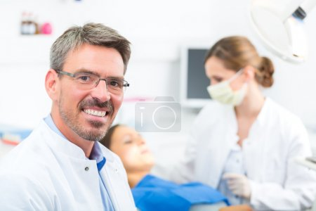 experienced Dentist in his surgery