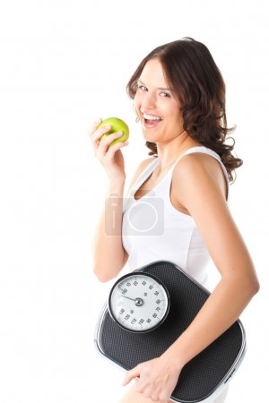 woman with scale under her arm and apple