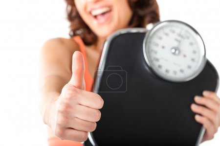 Young woman with measuring scale