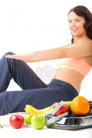 Diet and sport - woman is doing sit-ups