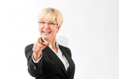 Mature woman point finger on the viewer