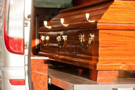 Funeral with coffin in hearse