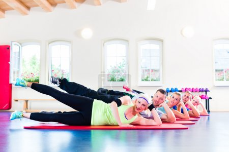Group of fitness people in gym at aerobics