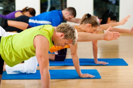 Stretching and gymnastics in fitness club or gym