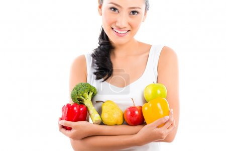Asian woman eating healthy fruit