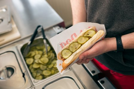 Hotdog - friendly salesman and fresh ingredients i...