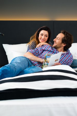 couple in Hotel in bed with wifi and computer