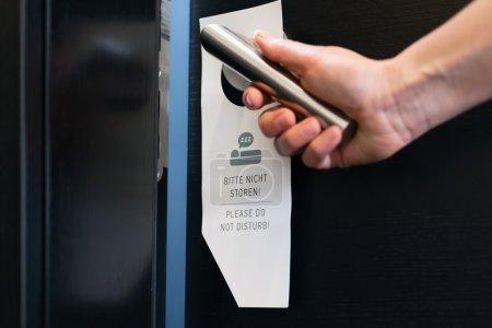 Please do not disturb sign on a room door in hotel