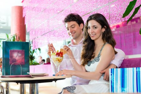 couple enjoying time in ice cream parlor