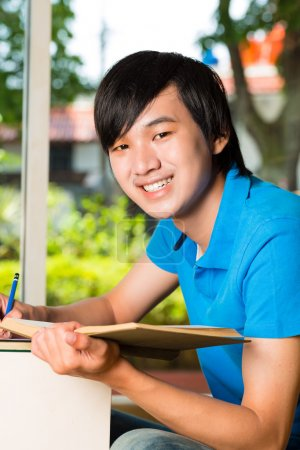 Asian student reading book or textbook learning