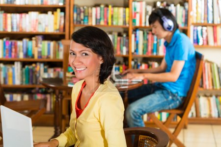 Photo for Students write in library learning on the Laptop - Portrait of a female student - Royalty Free Image