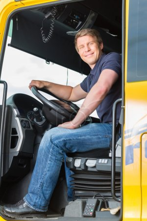Forwarder or truck driver in drivers cap