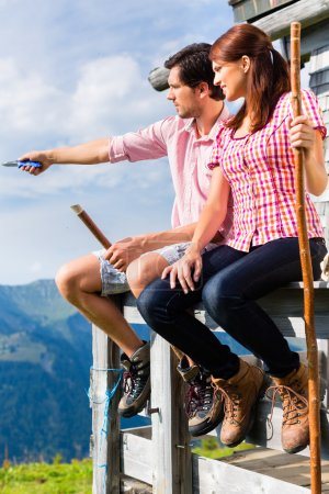 Alps - Man and woman sitting at cabin in tirol