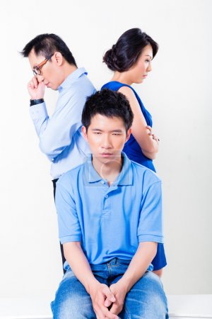 Young Chinese boy suffering from parents divorce