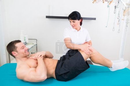 Physiotherapist or sport doctor patient in practice