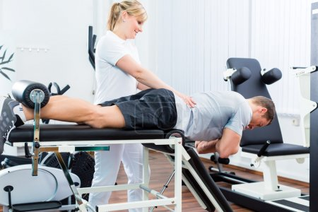 Physiotherapist or sport doctor with patient
