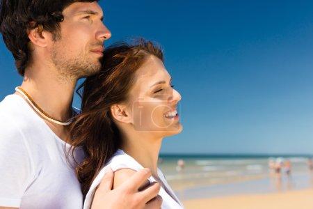couple on the ocean beach enjoying their summer vacation