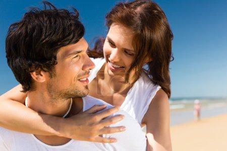 Couple enjoying freedom on the beach