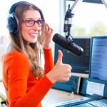 Female Presenter in radio station hosting show for...