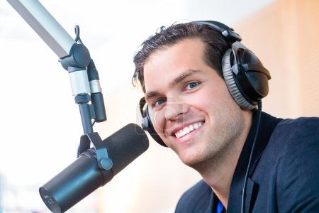 Presenter or host in radio station hosting show fo...