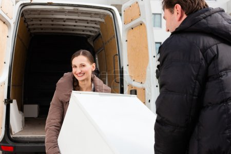 Young couple loading a moving truck