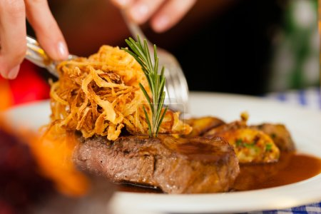 Eating in Bavarian restaurant or pub