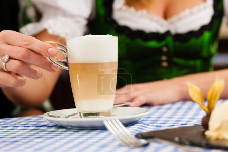 woman in traditional Bavarian Tracht in restaurant or pub