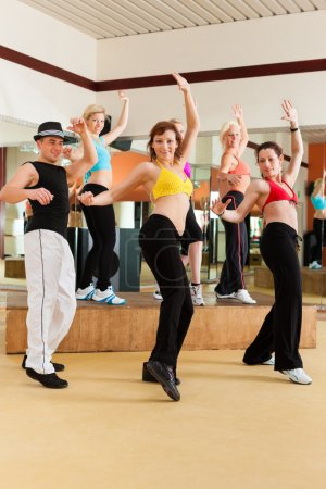 young people dancing in a studio