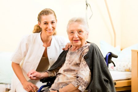 nurse and female senior in nursing home