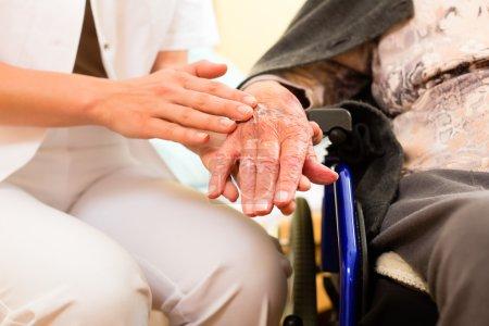 nurse and female senior in nursing home